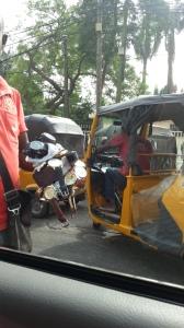 A 'maura' or 'napep' - a 3-wheel open door car